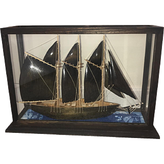 Arts & Craft Style Hand-Carved Wooden Boat with Wooden Sails in Glass Display Case