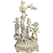 Signed Vintage White Capodimonte matte porcelain sculpture with angels cherubs children on a tree swing