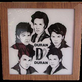 Vintage Duran Duran Black Image's on White Painted Glass In Original Cardboard Frame.