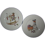 Set of Two Lenox Decorated Plates.  Boy on Rocking Horse.  Girl with Baby Buggy Filled with Dolls