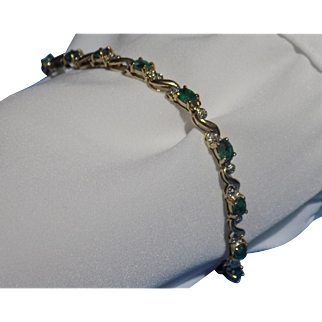 Vintage Bracelet Yellow Gold with Fully Faceted Oval Shaped Prong Set Emeralds & Round Diamonds - Ladies - 10 karat 10k