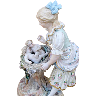 Superb large antique mother and babies bisque figurine