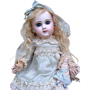 As found adorable closed mouth JUMEAU Bebe in rare size 2 with its trunk and trousseau.
