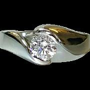 Hallmarked Platinum Diamond Ring set with a Round Brilliant cut Fine Quality Diamond