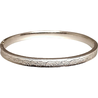 Hallmarked Sterling Silver Bangle Bracelet with a Carved Design. Free U.S. Shipping