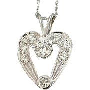14 Karat White Gold Heart Shaped Diamond Pendant on a 14 Karat White Gold Woven Rope Style Chain