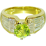 18 Karat Yellow Gold Invisible Channel set Diamond Ring with a Peridot Center Gemstone