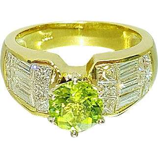 Hallmarked 18 Karat Yellow Gold Invisible Channel set Diamond Ring set with a Round Peridot Center set Gemstone
