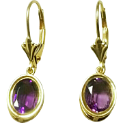 Pair of 10 Karat Yellow Gold Amethyst Dangle Style Earrings with Lever Back Fasteners. Free U.S. Shipping. International Shipping Charges May Vary.