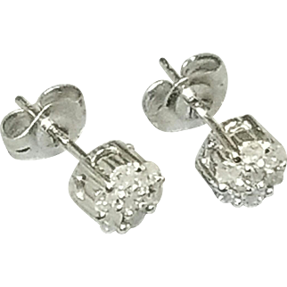 Pair of 10 Karat White Gold Cluster Style Diamond Earrings. Free U.S. Shipping. International Shipping Charges May Vary.