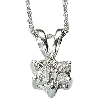 14 Karat White Gold Diamond Pendant in a Floral Cluster Style