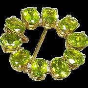 14 Karat Yellow Gold Peridot and Diamond Pendant Brooch. Free U.S. Shipping. International Shipping Charges May Vary.