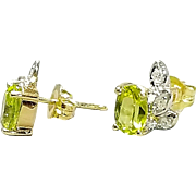 Pair of Hallmarked 14 Karat Peridot Gemstone and Diamond Pierced Style Earrings. Free U.S. Shipping. International Shipping Charges May Vary.