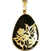 Hallmarked 14 Karat Yellow Gold and Onyx Pendant with Floral Gold Design