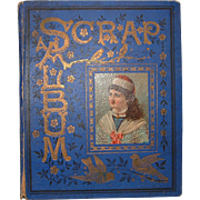 Antique Victorian Cobalt Blue Scrapbook with Lithographed Cover with Girl with 26 pages and 38 Scraps