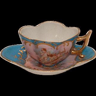 Antique LR Austria Small Quatrefoil Demitasse Cherubs Cupid Blue Cup and Saucer set