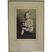 Vintage Blonde Little Girl with Bow and Baby Doll Cabinet/Envelope Professional Photograph