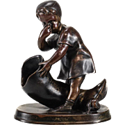 Continental Patinated Bronze Figurine, 19th Century. Girl Smelling Boot