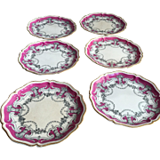 Set of 6 19th Century Continental porcelain plates gilt edging urns floral ornamentation