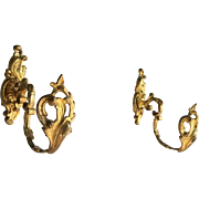 Pair antique French bronze ormolu curtain tie backs