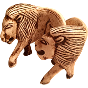 Hand Carved Bone Lion Sculptures from a trip to Africa in the 1950's, from a tribal artisan