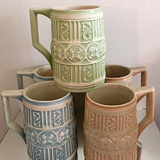 Roseville Old Ivory Set of 5 Steins in Green, Blue & Coral, Introduced in 1905