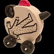 "Handpainted  Ceramic ""Runaway Teapot"" a whimsical 4 wheeled twist on a Tea Pot, circa 1980s - signed."
