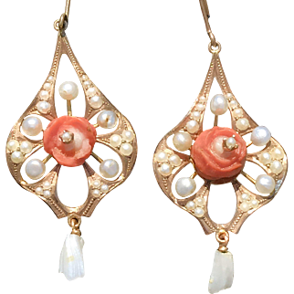 An adorable pair of Edwardian era tested 10k carved coral and pearl drop earrings.