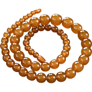 A vintage graduated butterscotch amber beaded necklace 70grams