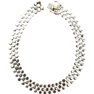 An eye catching substantial Sterling choker style necklace.