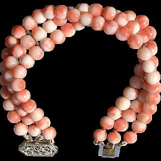A lovely vintage 3 strand blush coral bracelet with a 14k clasp