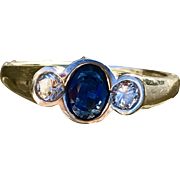 A classic 14k white gold diamond and sapphire bezel set ring.