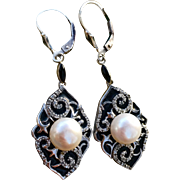An elegant pair of Sterling Art Deco style cultured pearl and enamel leverback earrings