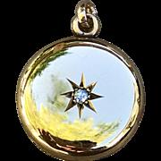 A lovely engraved antique 14k diamond locket