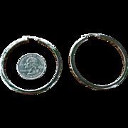 A classic pair of  large sterling hoop earrings