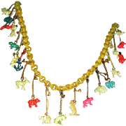 Vintage Cracker Jack Charms on Old Yellow Necklace Chain