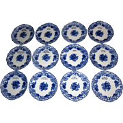 Twelve 19th Century Blue and White Porcelain Dinner Plates with Engraved Advertising