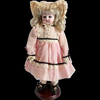 "Unique Ernst Heubach ""D"" Turned Shoulder Head Doll With Mechanical Mechanism"