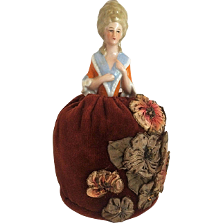 High Gloss Porcelain (China) Pincushion Half Doll With Molded Clothes