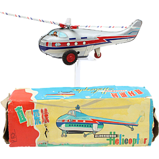China Shanghai tin toy MS 101 clockwork helicopter with original box