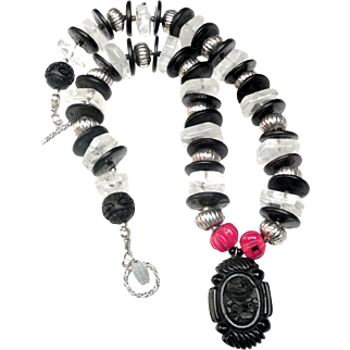 Carved Jet Pendant on Necklace of  Natural Rock Crystal, Coconut Discs; Traditional Silver; Dyed Bamboo Coral and Carved Lacquer