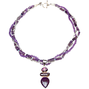 Sterling Silver Pendant Set with Sugilite and Baroque Pearl, on Three Strand Necklace of Amethyst, Fluorite, and Sterling Silver