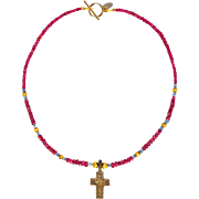 Bronze Cross on Rubies, Tanzanite and 18 ct Gold