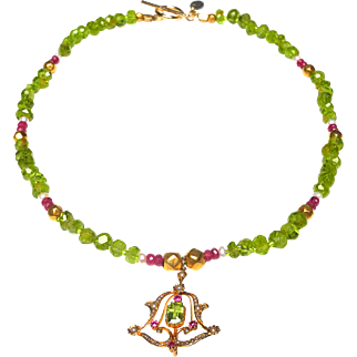 15 Carat Gold  pendant on Necklace of peridot and rubies