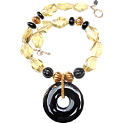Stunning Natural Lemon Quartz Natural Onyx and Traditional Gold Plated Beads Support a Polished Natural Onyx Bi Disc