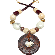 Brown Nephrite Jade Carved Disc, Carved Bone Polar Bear, Natural Coral, Magnesite, Wood and Traditional Old Vermeil Beads