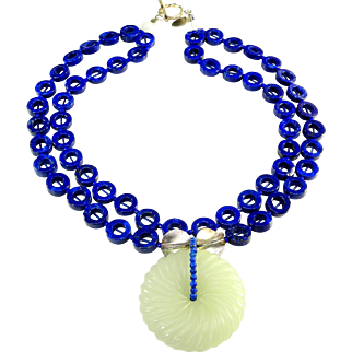 Striking Double Strand Necklace of Brilliant Blue Lapis Discs with carved White Nephrite Jade Bi Disc