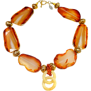 Interlocking Carved Nephrite Jade Discs on a Necklace of Carnelian and Gold Plated Beads