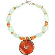 Celtic Carnelian Disc on a Necklace of Smoky Aquamarine, Carnelian and Gold Plated Beads