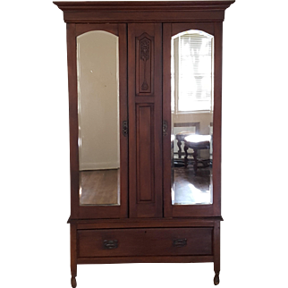 Victorian Style Armoire With Mirrored Doors and Bottom Drawer